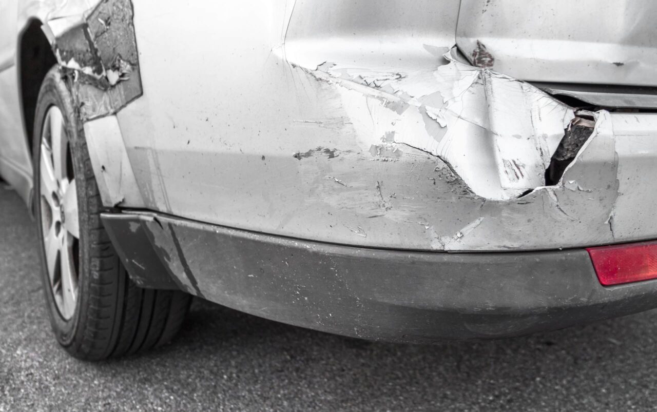 grey car with scratches and dent